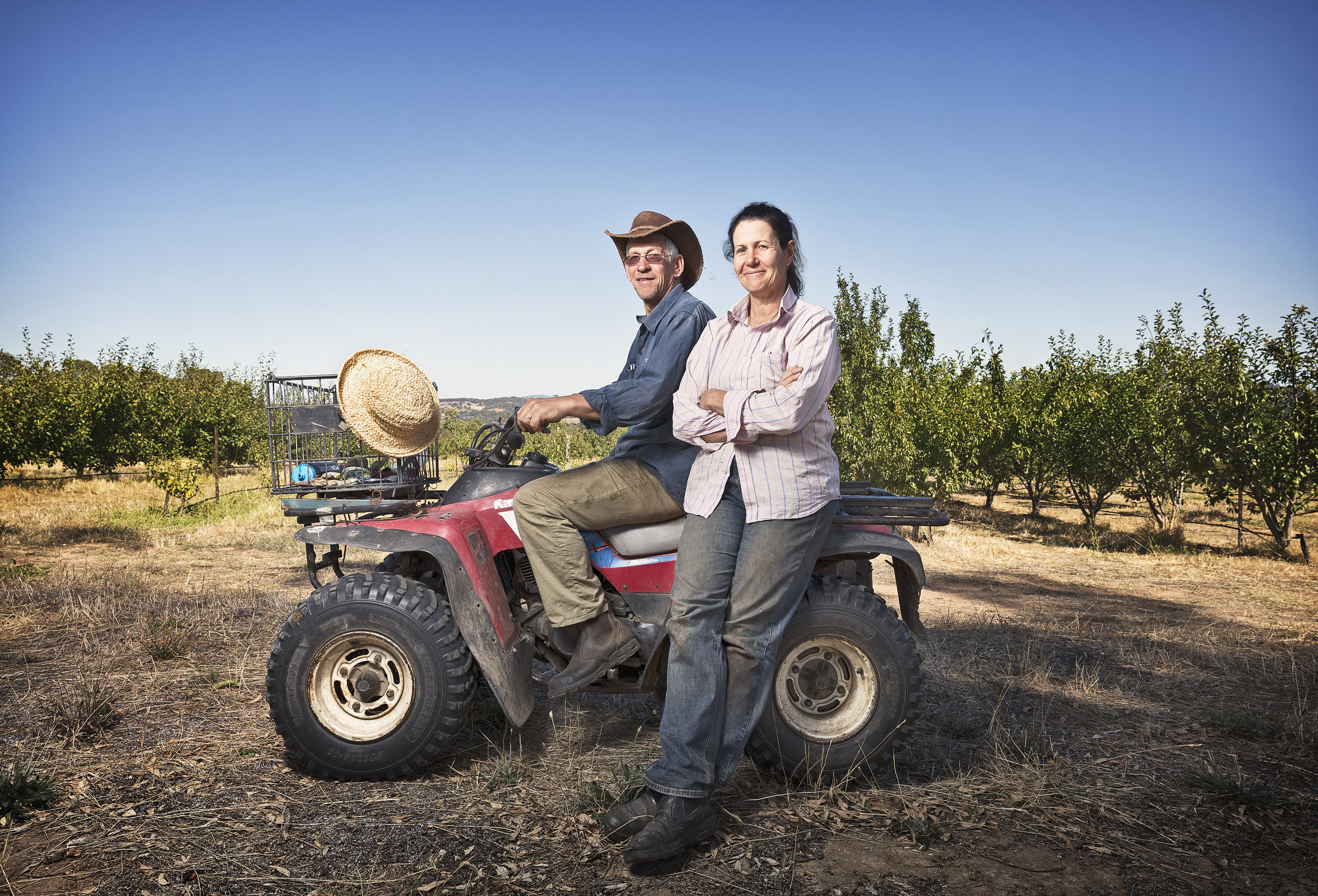David and Katie Finlay on quad bike at Mt Alexander Fruit Gardens.